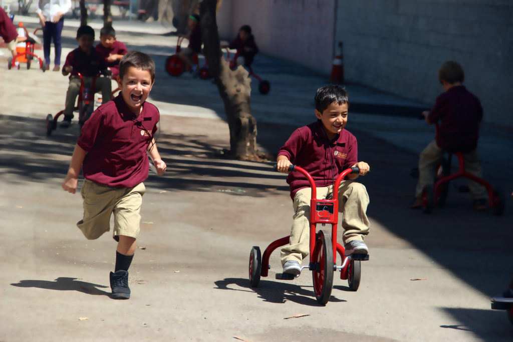Learning how to ride a tricycle is so much fun!